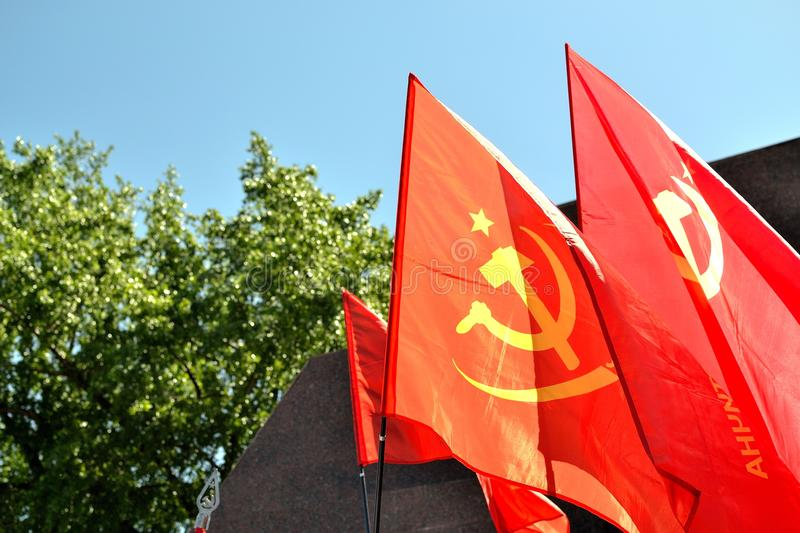 Soviet union flags. And blue skies royalty free stock photo