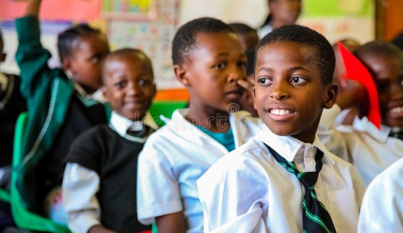 African Children in Primary School Classroom stock image