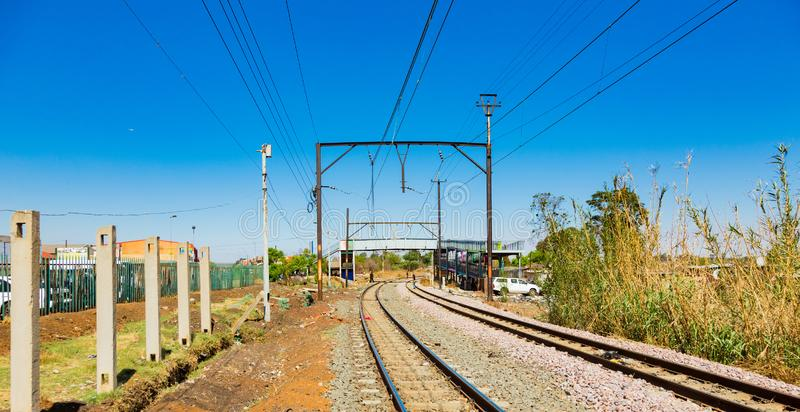 Commuter Train moving through the heart of Soweto, Johannesburg. Soweto, South Africa - September 08 2018: Commuter Train moving through the heart of Soweto stock photography