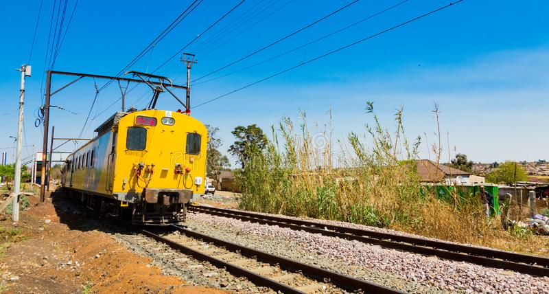 Commuter Train moving through the heart of Soweto, Johannesburg. Soweto, South Africa - September 08 2018: Commuter Train moving through the heart of Soweto stock image