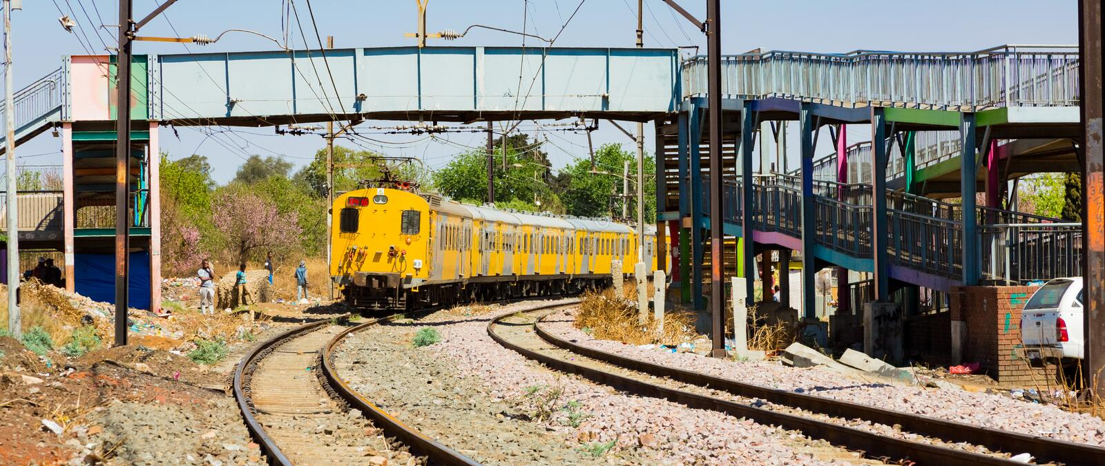 Commuter Train moving through the heart of Soweto, Johannesburg. Soweto, South Africa - September 08 2018: Commuter Train moving through the heart of Soweto stock images