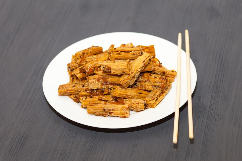 Soy asparagus Fuju in soy sauce royalty free stock image