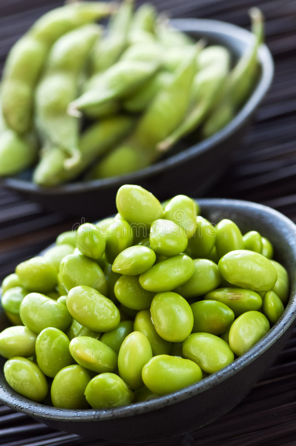 Soy beans in bowls stock image