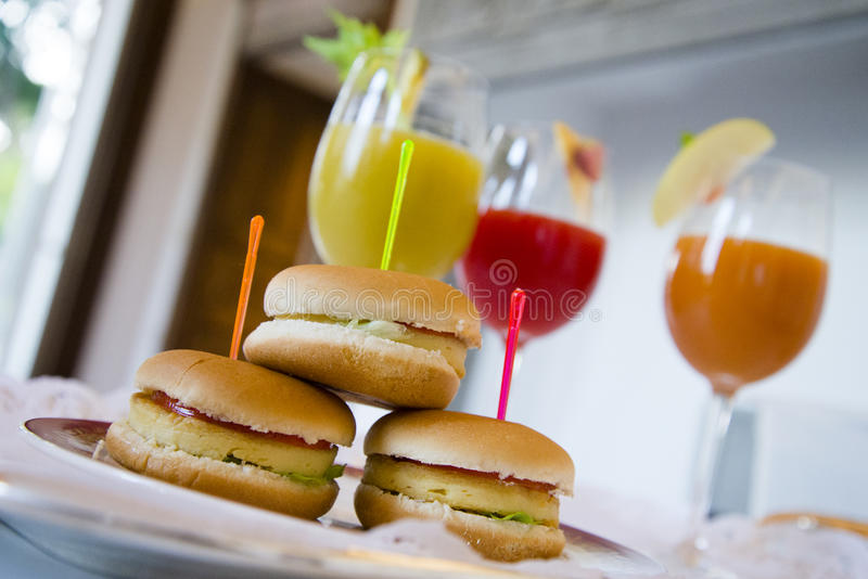 Soy burgers and fruit drinks, wealthy food. Soy burgers and fruit drinks served on a table stock photos