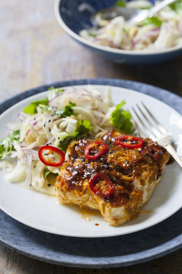 Soy and ginger glazed cod with fennel and onion salad stock photos
