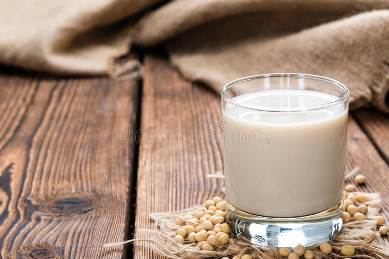 Soy Milk with some Seeds. (close-up shot) on wooden background stock images