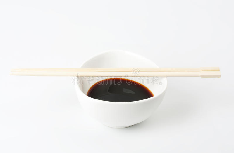 Soy Sauce in Suace-boat. Isolated over White stock photos