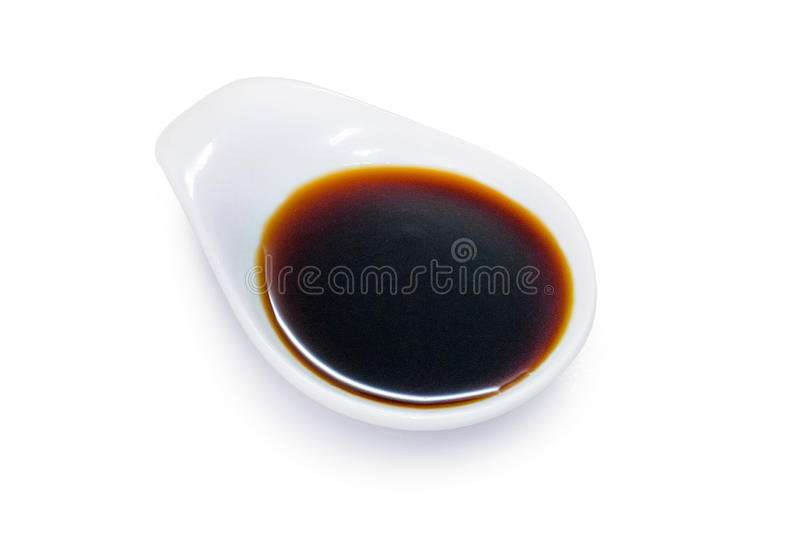 Soy sauce in a white bowl. Isolated on white background stock photos