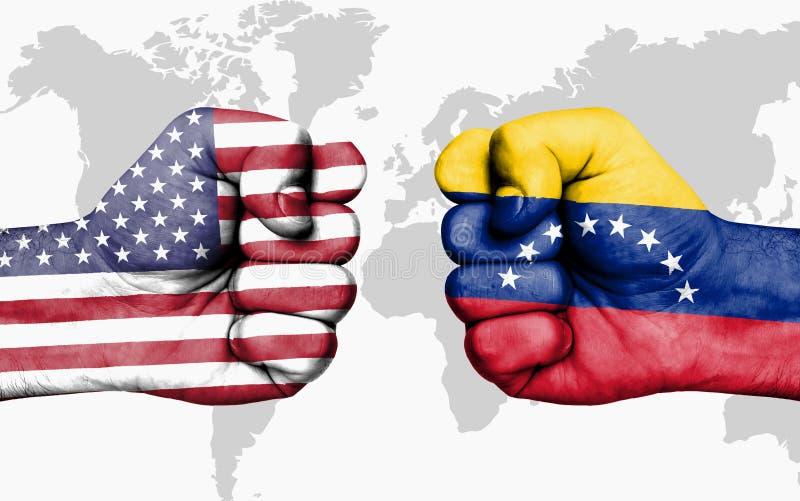 Soyez en conflit entre les Etats-Unis et le Venezuela - poings masculins photographie stock