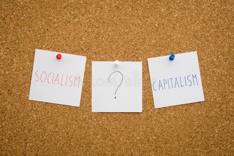 Sozialismus oder Kapitalismus lizenzfreie stockbilder