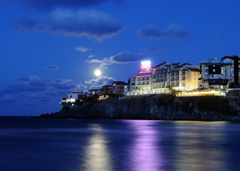 Sozopol new town by night. With full moon and clouds stock photo