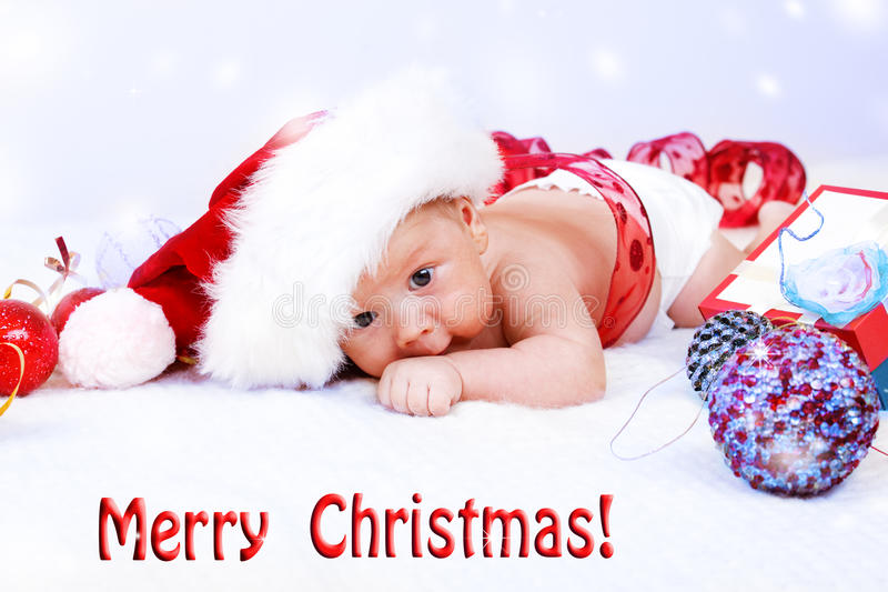 Spädbarn- och julgarnering royaltyfri fotografi
