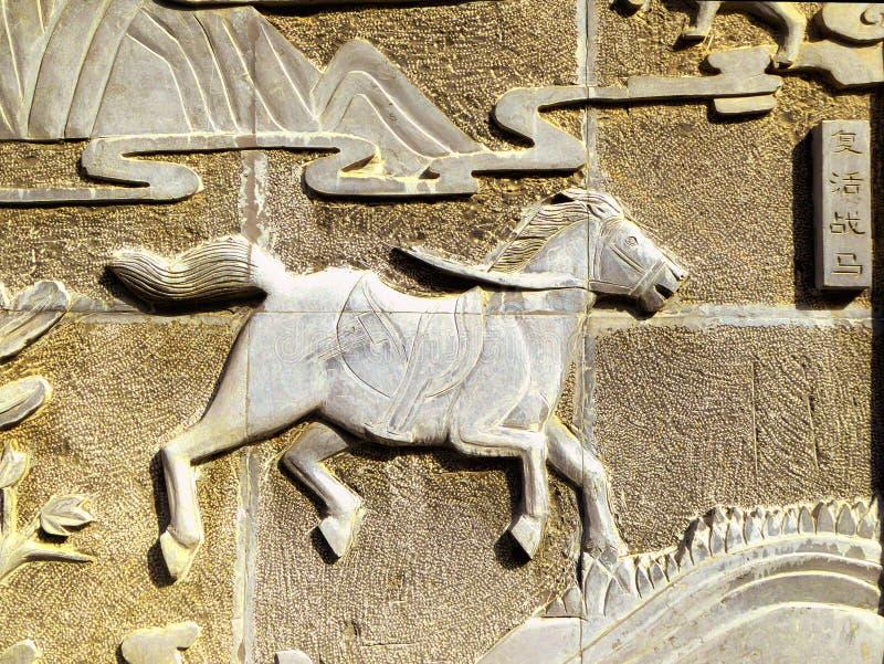 Spéléologie antique de pierre de cheval de guerre photos libres de droits