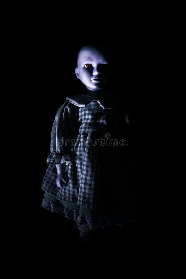 Spöka barnets docka figurera royaltyfri bild