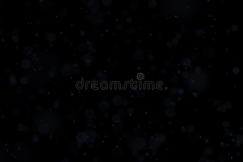Spławowego światła atmosferyczne cząsteczki odizolowywać na czarnej narzucie Maj używał na górze warstew w parawanowym trybie obraz royalty free
