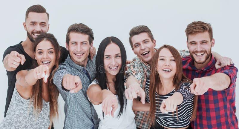 Spaßteam von den jungen Leuten, die auf Sie zeigen stockfoto