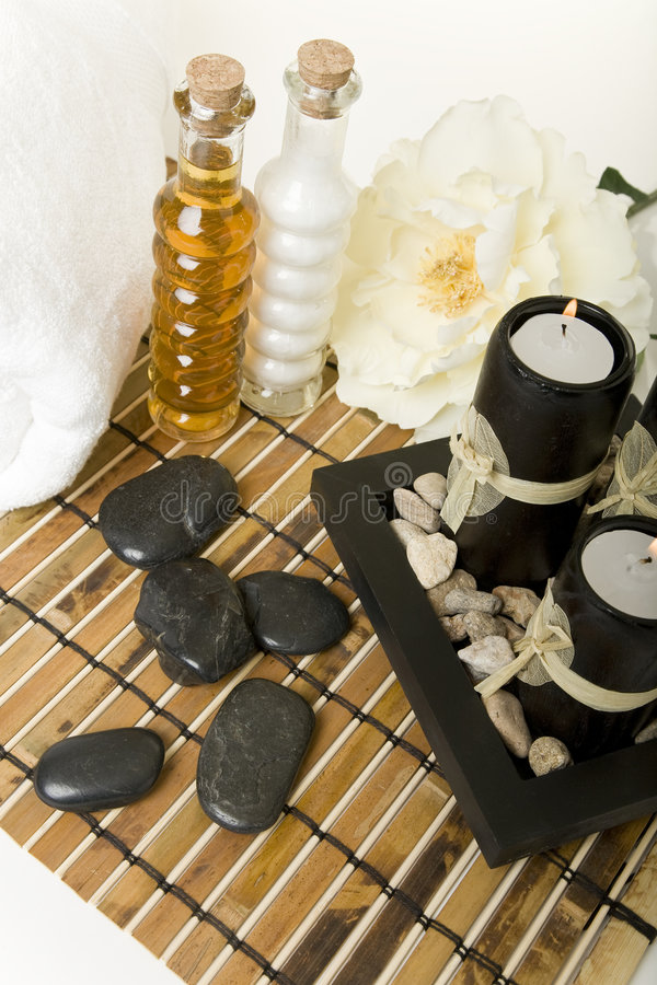 At the Spa. Spa products with massage stones, & aromatic candles stock photos