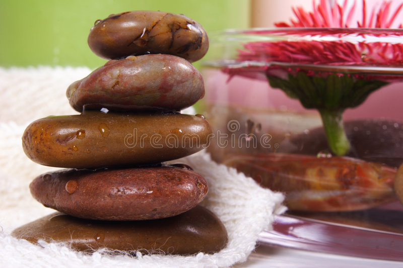 SPA. Composition with cosmetics, naianting daisy, stones and towel royalty free stock images