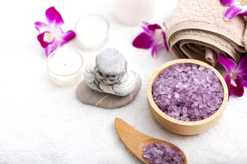 Spa accessories aromatic candle,orchid flower, salt scrub and towel.  stock photos