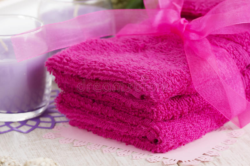 Spa accessories, towels, soap and candles stock image
