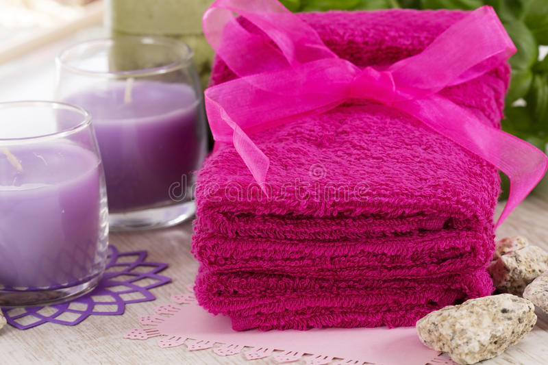 Spa accessories, towels, soap and candles royalty free stock photos