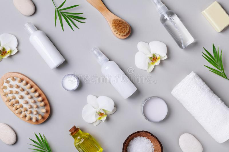 Spa, aromatherapy, beauty treatment and wellness background with massage brush, towel, orchid flowers and cosmetic products. royalty free stock images