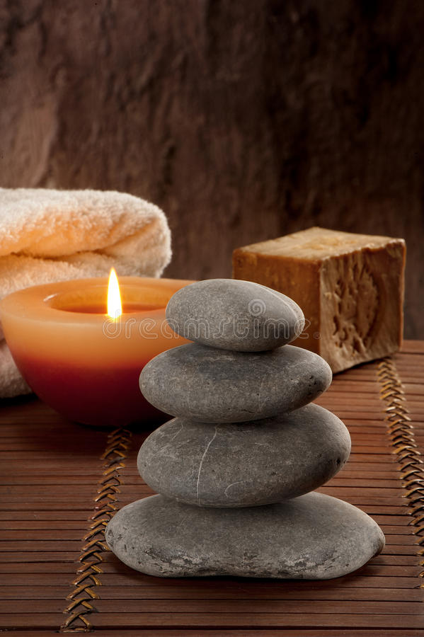 SPA atmosphere with four stones with candle light and soap stock images