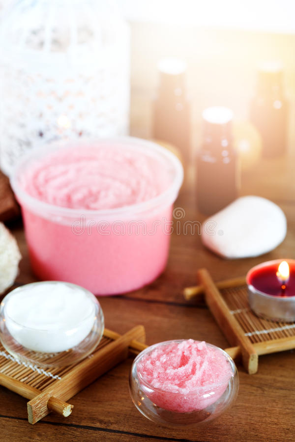 Spa background with candles and treatment products. Organic cosmetics for spa treatment. Selective focus. Lens flare stock photography