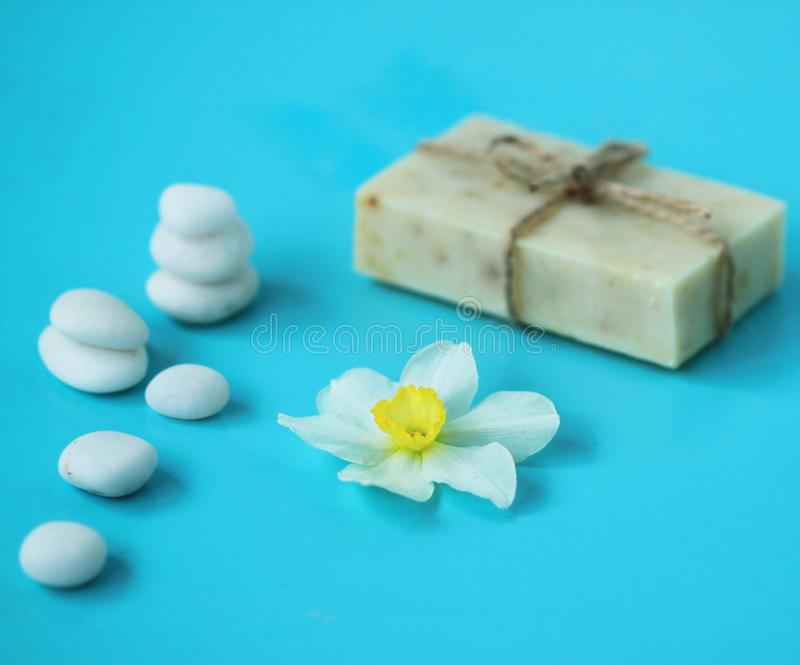 Stock-photo-spa-background-flowers-stones-soap-natural-composition stock image