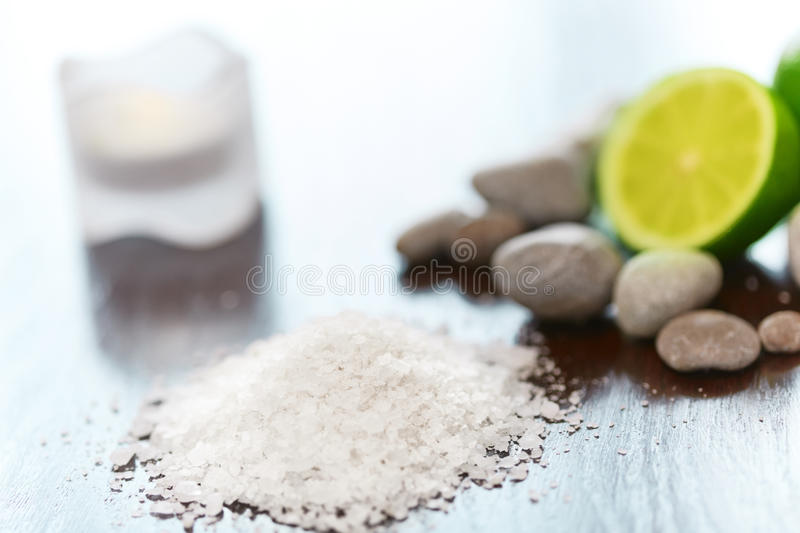 Spa Background. Sea Salt with Lime Stones and Candle . Body scru stock photos
