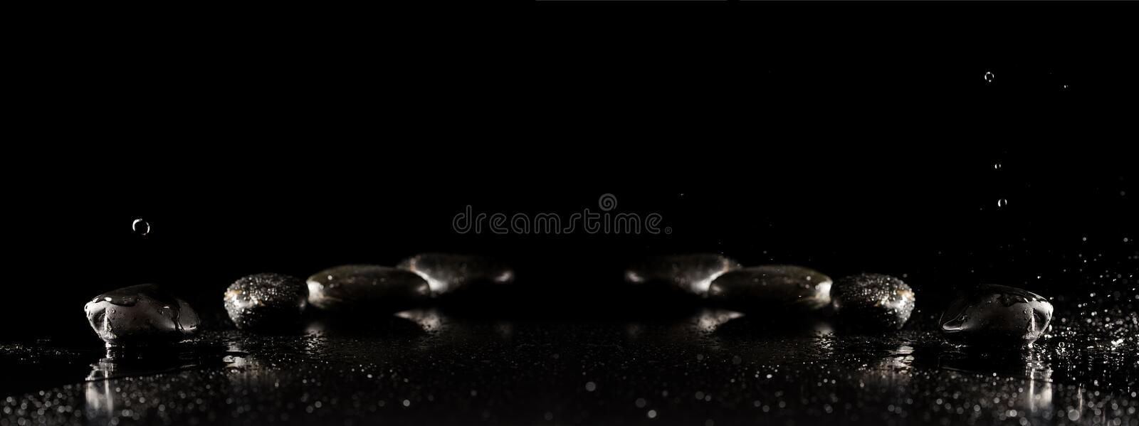 Spa background with wet basalt massage stones with water droplet royalty free stock photography