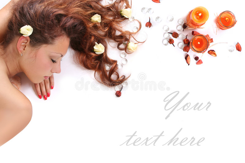 Spa banner. Beautiful long-haired girl relaxing in spa salon