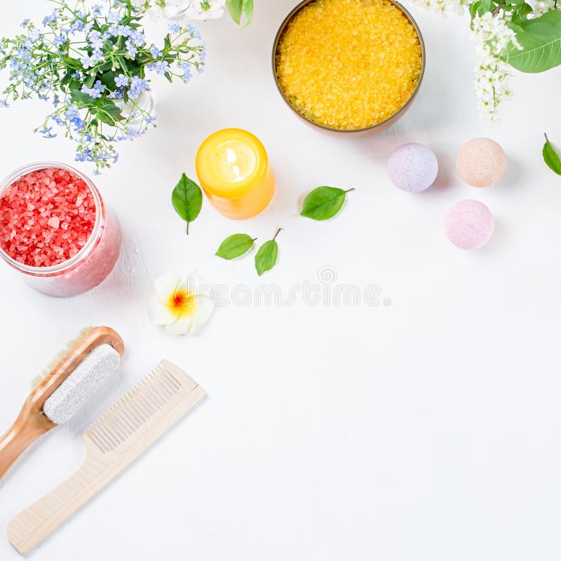 Spa and bath accessories with bath salts and beauty treatment products on white table. Wellness concept. Lay out stock images