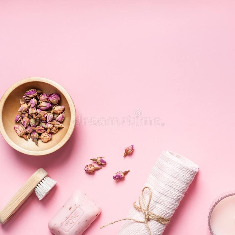 Spa, beauty cosmetics and body care treatment. Concept with copy space. Creative top view flat lay composition with bath accessories, organic DIY rose soap and royalty free stock image