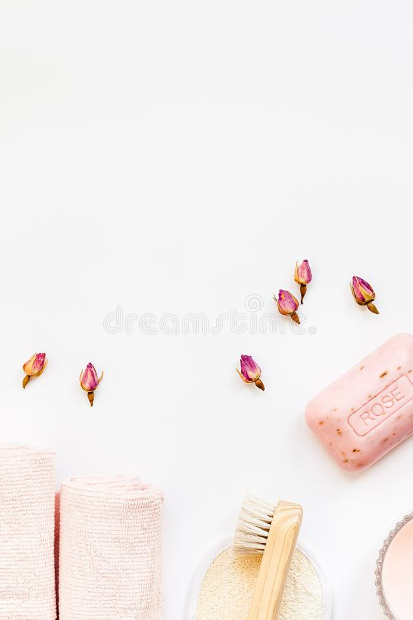 Spa, beauty cosmetics and body care treatment. Concept with copy space. Creative top view flat lay composition with bath accessories, organic DIY rose soap stock image