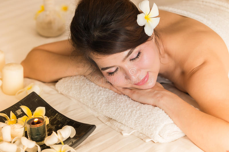 Spa beauty skin treatment woman on white towel. Gorgeous beautiful multiracial Caucasian / Asian female model with perfect skin l stock photos