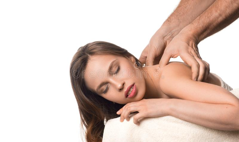 Spa beauty skin treatment woman on white towel. Masseurs hands massaging womans neck. stock photos