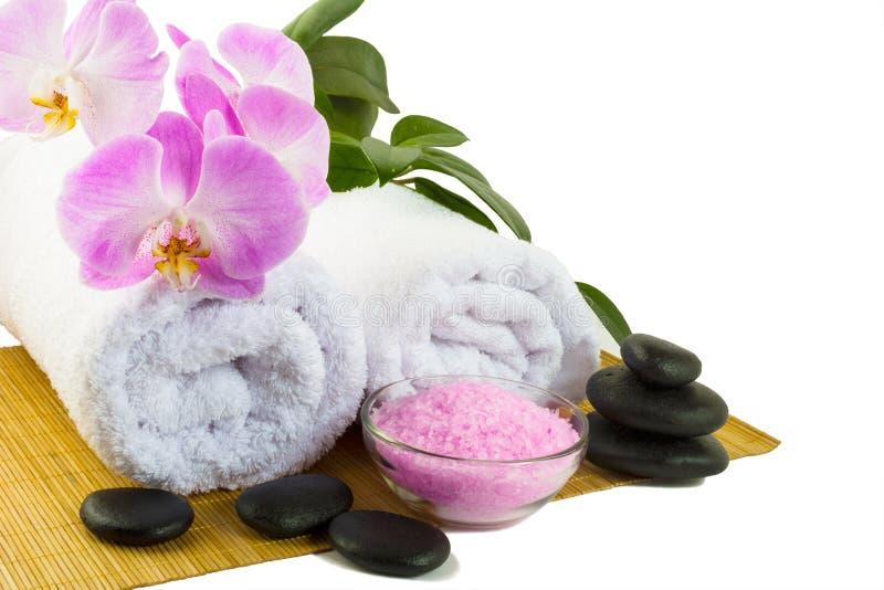 Spa begrepp med den rosa orkidén som isoleras på vit royaltyfria foton
