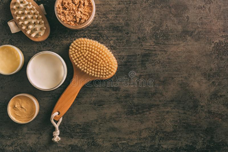 SPA and Body care products. Scrub, body creams and brush for massage. SPA background with copy space royalty free stock images