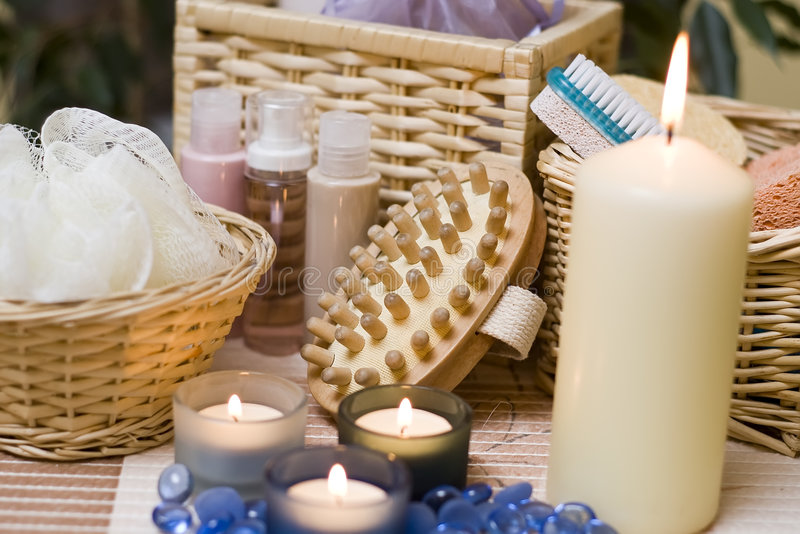 Spa candles composition. A spa composition with bath items and three blue candles in the foreground stock images