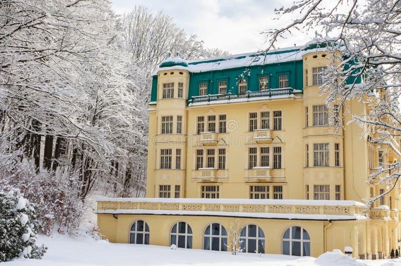 Spa center of small west Bohemian spa town Marianske Lazne. Marienbad in winter with snow - Czech Republic stock photo