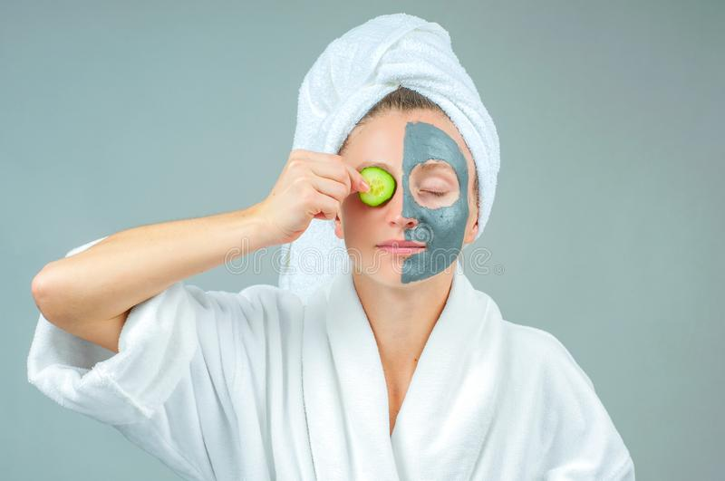 Beautiful young woman with clay facial mask. Skincare and beauty Concept stock photo