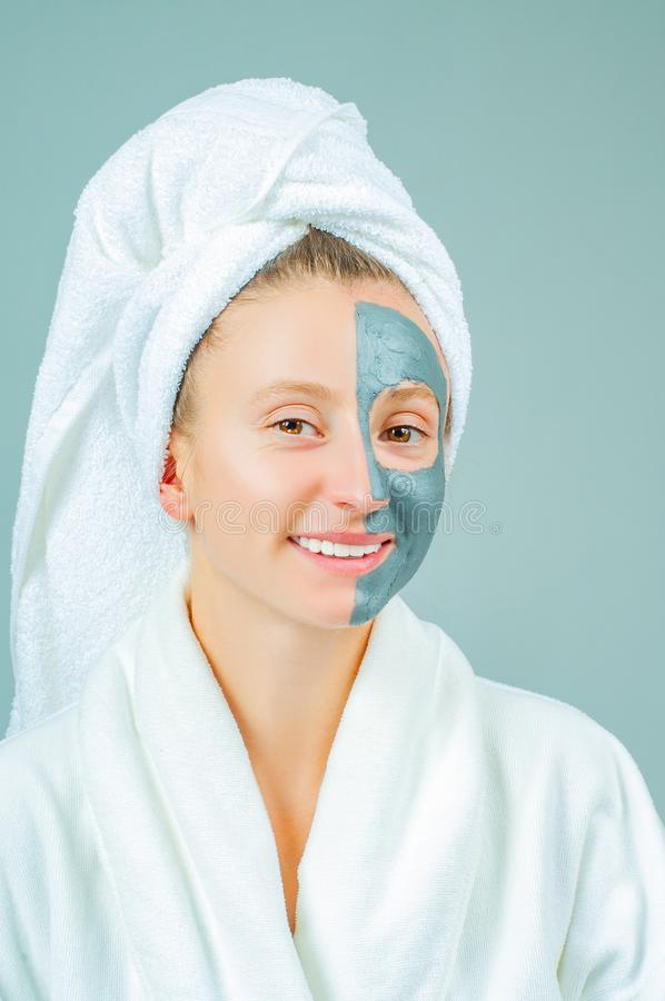 Beautiful young woman with clay facial mask. Skincare and beauty Concept royalty free stock photography