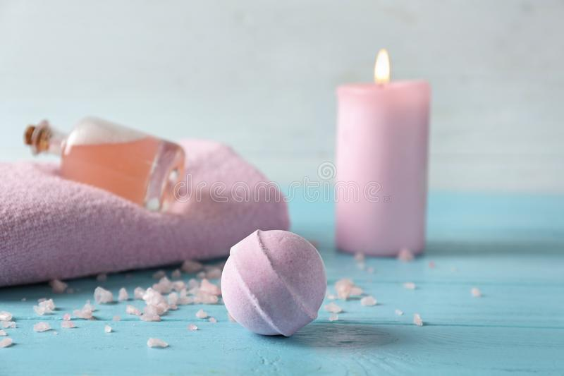 Spa composition with bath bomb on color table stock photos
