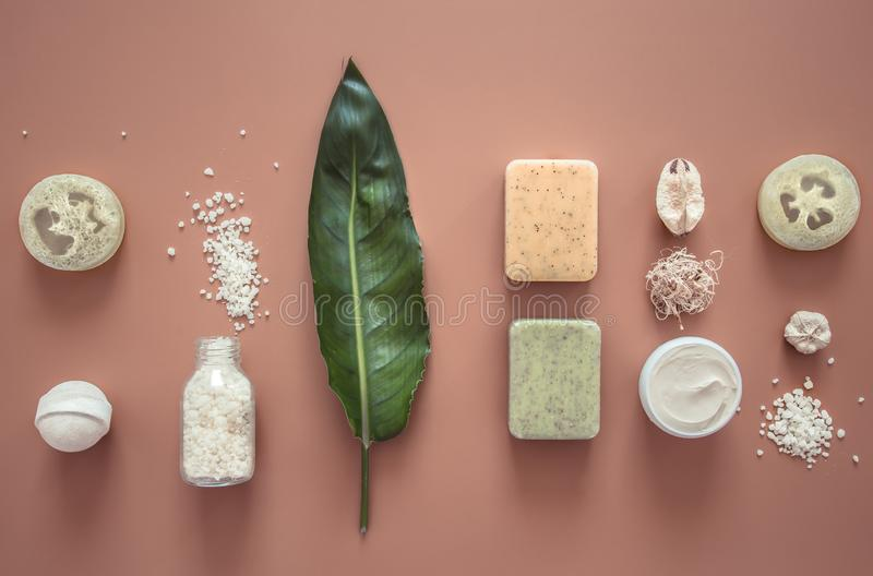 Spa composition with body care items on a colored background. Spa and body care concept . Flatlay stock photo