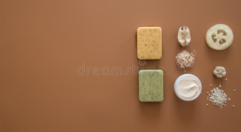 Spa composition with body care items on a colored background. Spa and body care concept . Flatlay stock image