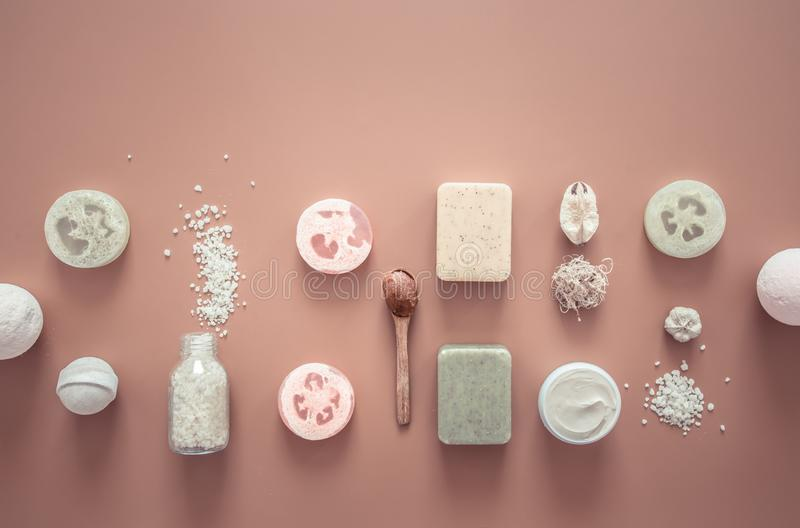 Spa composition with body care items on a colored background. Spa and body care concept . Flatlay stock images