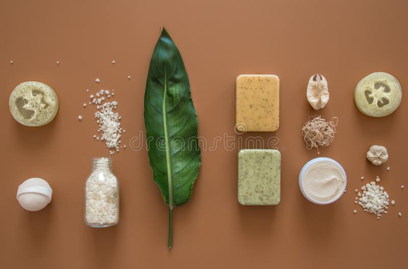 Spa composition with body care items on a colored background. Spa composition with body care items and tropical leaf on a colored background . Spa and body care royalty free stock photography