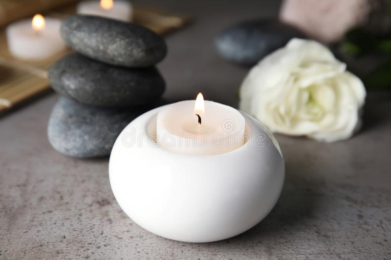Spa composition with burning candle. On table royalty free stock photos