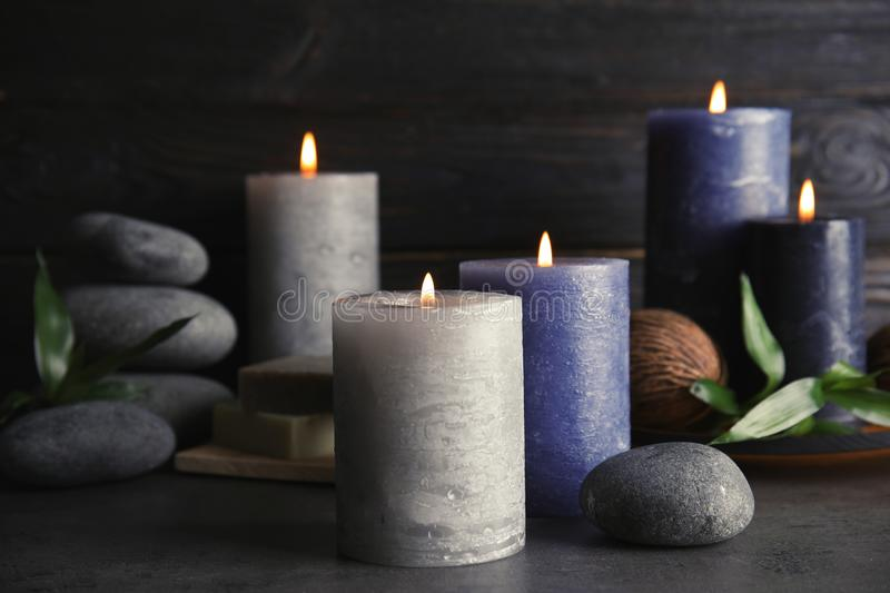 Spa composition with burning candles. On table royalty free stock photos